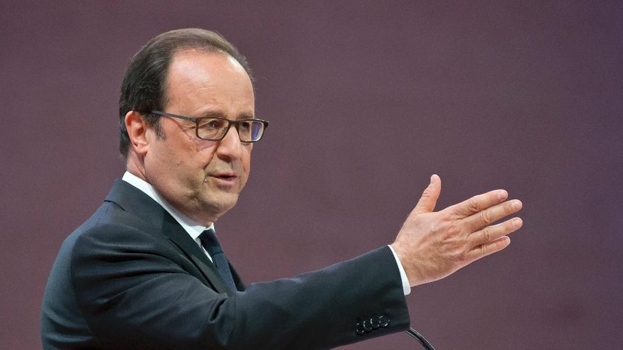 France's President Francois Hollande gestures as he speaks to scientists during the World Science Day a gathering of scientists from 57 countries at the Louvre museum in Paris, Tuesday, Sept. 27, 2016. France is also celebrating 350 years of it's academy of science. (AP Photo/Michel Euler, Pool)