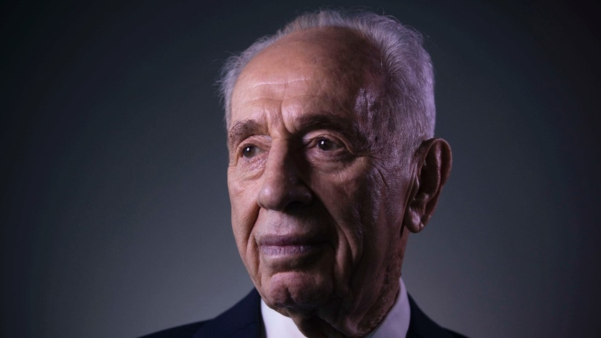 FILE - In this Monday, Feb. 8, 2016 file photo, Israel's former President Shimon Peres poses for a portrait at the Peres Center for Peace in Jaffa, Israel.