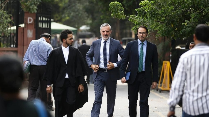 Italian ambassador to India, Lorenzo Angeloni, center, arrives at Supreme Court in New Delhi, India, Wednesday, Sept. 28, 2016. The court has decided to allow Italian marine Massimiliano Latorre be allowed to remain in Italy till an international tribunal decides on the jurisdiction of the case. (AP Photo/Saurabh Das)