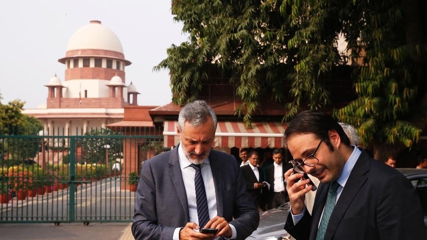 Italian ambassador to India, Lorenzo Angeloni, left, is seen outside the Supreme Court in New Delhi, India, Wednesday, Sept. 28, 2016. The court has decided to allow Italian marine Massimiliano Latorre be allowed to remain in Italy till an international tribunal decides on the jurisdiction of the case. (AP Photo/Saurabh Das)