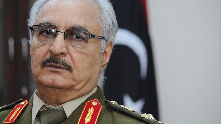 "FILE -- In this March 18, 2015 photo file photo, Gen. Khalifa Hifter speaks during an interview with The Associated Press, in al-Marj, Libya. Hifter, a powerful Libyan general whose forces recently captured several key oil facilities has rejected a U.N.-brokered government and said the country would be better served by a leader with ""high-level military experience."" In a series of written responses to questions from The Associated Press this week, Hifter said his army only recognizes the authority of the Libyan parliament based in the east, which has also rejected the U.N.-backed government in the capital, Tripoli. (AP Photo/Mohammed El-Sheikhy, File)"