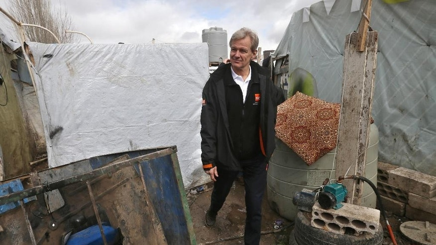 FILE- In this Wednesday, Feb. 25, 2015 file photo, Jan Egeland, the secretary general of the Norwegian Refugee Council and former U.N. humanitarian chief, walks between tents at a Syrian refugee camp in the town of Marej in the Bekaa valley, east Lebanon. Egeland, one of the mediators who helped broker the 1993 Oslo Peace Accord, remembered Shimon Peres as a charismatic leader who saw peace with the Palestinians as key to Israel's future, as he told The Associated Press by phone on Wednesday, Sept. 28, 2016. (AP Photo/Hussein Malla, File)