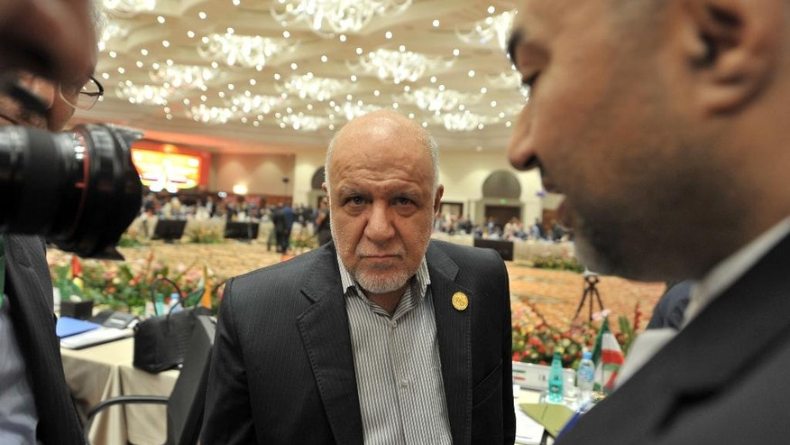 Iran's Oil Minister Bijan Namdar Zanganeh attends the opening session of the 15th International Energy Forum Ministerial meeting in Algiers, Algeria, Tuesday, Sept. 27, 2016. At meetings in Algeria this week, energy ministers from OPEC and other oil-producing countries are discussing whether to freeze production levels to boost global oil prices. (AP Photo/ Sidali Djarboub)