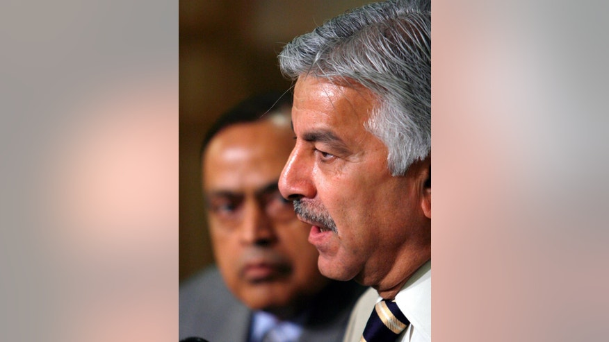 "FILE - In this Friday, April 25, 2008 file photo, Pakistani Petroleum Minister Khawaja Mohammed Asif, right, speaks while his Indian counterpart Murli Deora looks on during a joint news conference in Islamabad, Pakistan. Pakistan's Defense Minister says its nuclear-armed rival India will ""disintegrate"" when the people living in disputed Himalayan region of Kashmir got independence from New Delhi. Khawaja Muhammad Asif said Wednesday, Sept. 28, 2016 that Pakistan will continue to extend moral support to Kashmiri people in their struggle. (AP Photo/B.K.Bangash, File)"