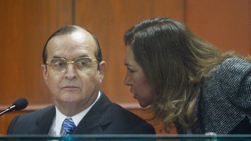 FILE - In this June 30, 2008 file photo, Vladimiro Montesinos, left, listens to his lawyer Estela Valdivia as he testifies at the trial of Peru's former President Alberto Fujimori in Lima. On Monday Sept. 26, 2016, Montesinos was sentenced to 22 years in jail for the forced disappearance of a professor and two students in 1993. He was already serving long sentences for crimes against humanity and arms trafficking. (AP Photo/Martin Mejia, File)