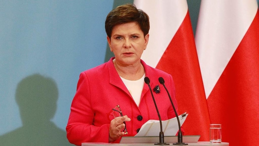 Poland's Prime Minister Beata Szydlo tells reporters that she has dismissed her finance minister and given his job to Deputy Prime Minister Mateusz Morawiecki at her office in Warsaw, Poland, Wednesday, Sept. 28, 20160. She said the dismissal was dictated by the need to speed up economic reforms. (AP Photo/Czarek Sokolowski)