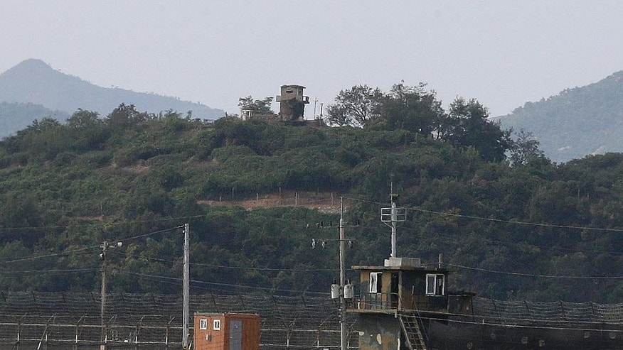 Military guard posts of North Korea, rear, and South Korea, bottom, are seen in Paju, at the border with North Korea, South Korea, Thursday, Sept. 29, 2016. South Korea's military said Thursday that a North Korean soldier had crossed the border between the rivals to defect. (AP Photo/Ahn Young-joon)