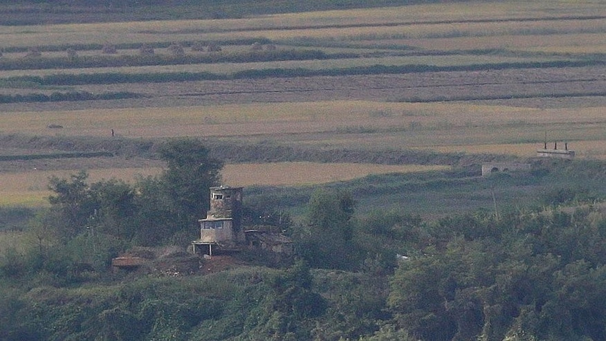 A hilltop North Korean military guard post in North Korea's Kaepoong is seen over the border from an observatory in Paju, South Korea, Thursday, Sept. 29, 2016. South Korea's military said Thursday that a North Korean soldier had crossed the border between the rivals to defect. (AP Photo/Ahn Young-joon)