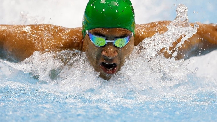 FILE: In this Sept. 1, 2012 file photo, Achmat Hassiem of South Africa swims in the men's 100-meter butterfly race at the 2012 Paralympics games in London. A medal-winning Paralympian from South Africa lost part of his right leg in a great white shark attack a decade ago. This week, he is an ambassador for sharks at a U.N. wildlife conference. Hassiem on Wednesday, Sept. 28, 2016 called for tighter controls on trade in some shark species as well as mobula rays, saying their numbers are in sharp decline. (AP Photo/Alastair Grant, File)