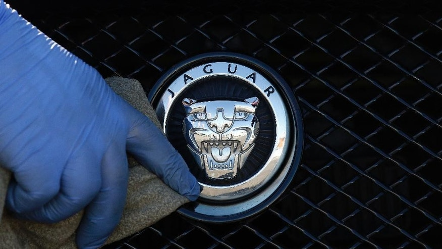 A worker polishes a Jaguar logo on a car at a Jaguar dealer in London, Wednesday, Sept. 28, 2016. This should be a fine time for British carmakers, with sales increasing and investments coming online, but for one major storm front, the impossible-to-predict ramifications of the June vote to leave the European Union. Most expect Brexit to be disruptive, and to raise costs, but the hard talk negotiations on the crucial issues of tariffs and the free movement of labor are still months away and will possibly take years to resolve. That means years of uncertainty over the cost of building cars in Britain and the ease of exporting them to other EU countries. (AP Photo/Frank Augstein)