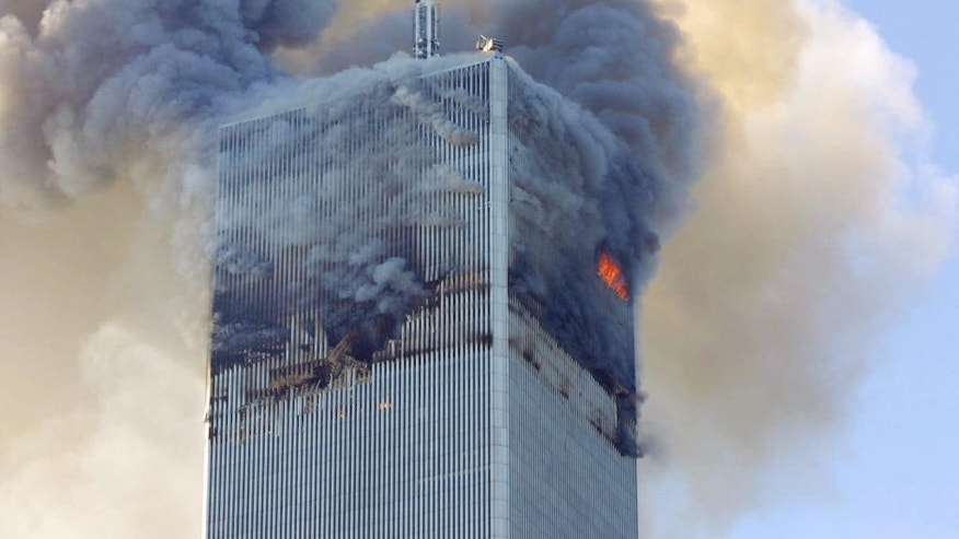 FILE- In this Tuesday, Sept. 11, 2001 file photo, fire and smoke billows from the north tower of New York's World Trade Center after terrorists crashed two hijacked airliners into the World Trade Center and brought down the twin 110-story towers. A bill passed by Congress allowing the families of 9/11 victims to sue the Saudi government has reinforced to some in the Arab world a long-held view that the U.S. only demands justice for its own victims of terrorism, despite decades of controversial U.S. interventions around the world. (AP Photo/David Karp, File)