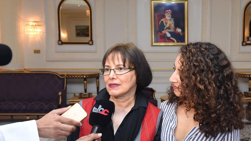 "This photo made available by Oman News Agency, shows retired Iranian-Canadian professor Homa Hoodfar, left, speaking to the media in Muscat airport, Oman, after being released by Iranian authorities, Monday, Sept. 26, 2016, Canadian-Iranian retired professor was released from prison on ""humanitarian grounds"" and flown out of Iran on Monday, Iran's state-run news agency said, ending her months of detention alongside other dual nationals swept up by hard-liners in the security services. (Oman News Agency via AP)"