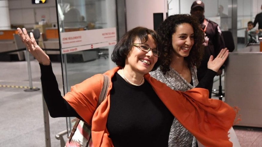 Iranian-Canadian professor Homa Hoodfar smiles as she arrives in Montreal on Thursday, Sept. 29, 2016. The retired anthropology professor spent nearly four months in prison in Iran.  (Ryan Remiorz/The Canadian Press via AP)