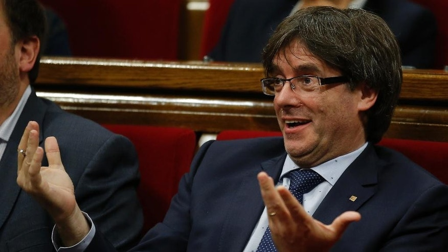 President of Catalonia Carles Puigdemont gestures during a debate on his presidency at the Parliament in Barcelona, Spain, Thursday, Sept. 29, 2016. Catalan regional lawmakers are debating regional President Carles Puigdemont's latest promise to hold another independence referendum next September with or without agreement from Spain. (AP Photo/Manu Fernandez)