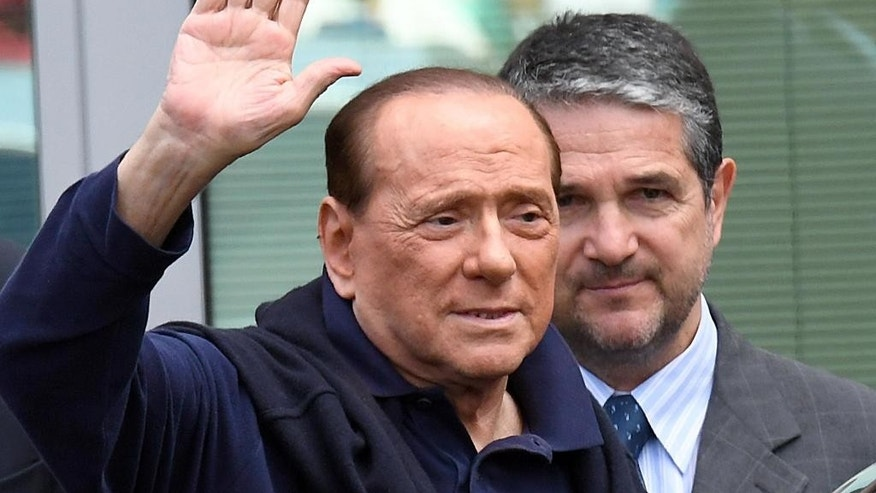FILE -- In this file photo taken on July 5, 2016, ex-Premier Silvio Berlusconi salutes as he leaves the San Raffaele hospital three weeks after undergoing heart surgery, in Milan, Italy. Silvio Berlusconi is marking his 80th birthday quietly with his family, amid a flurry of greetings and reflections on his influence over a political career spanning three decades. (Daniel Dal Zennaro/ANSA via AP Photo)
