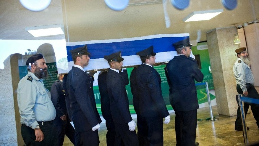 Members of the Knesset guard carry the coffin of former Israeli President Shimon Peres at the Knesset plaza in Jerusalem, Thursday, Sept. 29, 2016. Peres died early Wednesday from complications from a stroke. He was 93. (AP Photo/Oded Balilty)