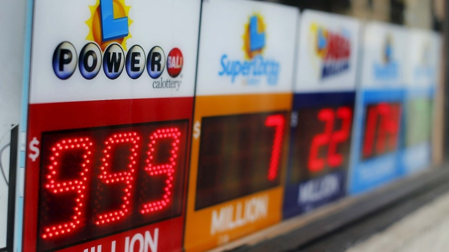 Jan. 13, 2016: A Powerball sign shows $999 million outside a corner corner store in San Diego.