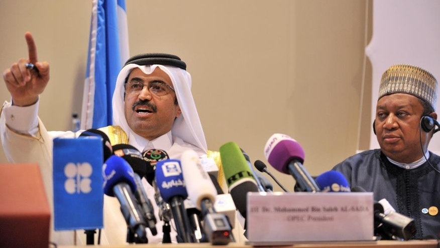 In this photo dated Wednesday, Sept. 28, 2016, Minister of Energy and Industry of Qatar, Bin Saleh Al-Sada, seated next to acting Secretary General of OPEC Mohammed Barkindo, gestures during a closing press conference at the end of meeting of oil ministers of the Organization of the Petroleum Exporting countries, OPEC, in Algiers, Algeria. OPEC nations reached a preliminary agreement Wednesday to curb oil production for the first time since the global financial crisis eight years ago, in an effort to reduce a global glut of crude that has depressed oil prices for more than two years and weakened the economies of oil-producing nations. (AP Photo/Sidali Djarboub)