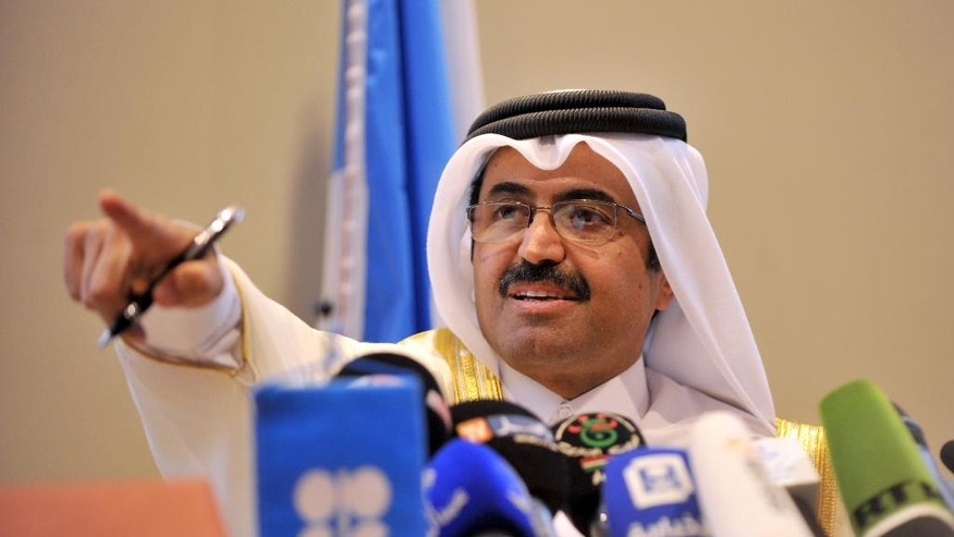 In this photo dated Wednesday, Sept. 28, 2016, minister of Energy and Industry of Qatar, Bin Saleh Al-Sada gestures during a closing press conference at the end of a meeting of oil ministers of the Organization of the Petroleum Exporting countries, OPEC, in Algiers, Algeria. OPEC nations reached a preliminary agreement Wednesday to curb oil production for the first time since the global financial crisis eight years ago, in an effort to reduce a global glut of crude that has depressed oil prices for more than two years and weakened the economies of oil-producing nations. (AP Photo/Sidali Djarboub)