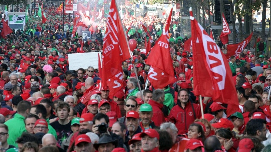 Members of trade unions and others march during a general strike in Brussels on Thursday, Sept. 29, 2016. Demonstrators marched on Thursday against cost cutting measures and government reforms. (AP Photo/Olivier Matthys)
