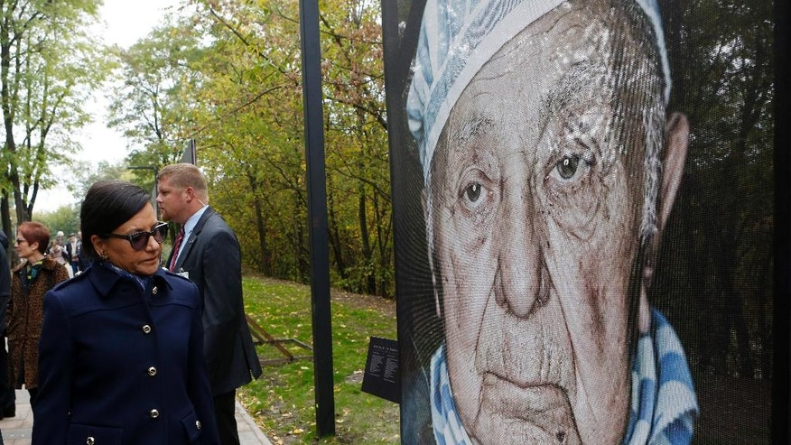 U.S. Commerce Secretary Penny Pritzker, left, attends a tour in Babi Yar ravine where Nazi troops machine-gunned tens of thousands of Jews during WWII, in Kiev, Ukraine, Thursday, Sept. 29, 2016. Ukraine marked the 75th anniversary of the 1941 Babi Yar massacre. (AP Photo/Sergei Chuzavkov)