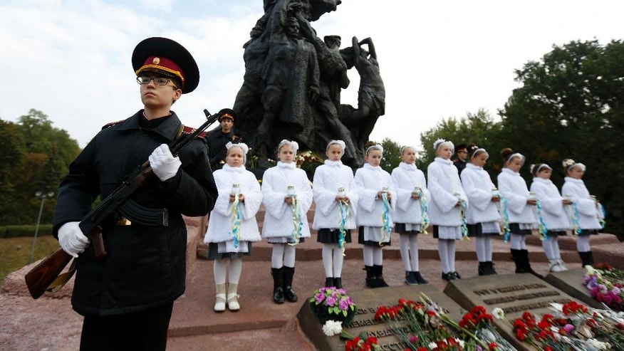Kiev Cadets honor guard takes part in commemorative events at the Babi Yar ravine where Nazi troops machine-gunned tens of thousands of Jews during WWII, in Kiev, Ukraine, Thursday, Sept. 29, 2016. Ukraine commemorated the 75th anniversary of the 1941 Babi Yar massacre. (AP Photo/Sergei Chuzavkov)