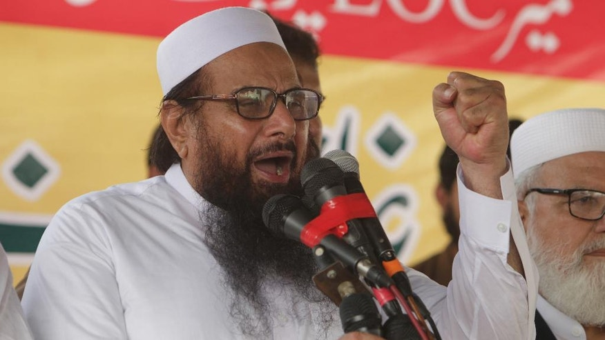 Hafiz Saeed, leader of Jamaat-ud-Dawa address an anti-Indian rally in Lahore, Pakistan, Friday, Sept. 30, 2016. The founding member of banned Lashkar-e-Taiba militant group and head of its charity Jamaat-ud-Dawa has pledged to take revenge on India for killing innocent Kashmiri people. (AP Photo/K.M. Chaudary)