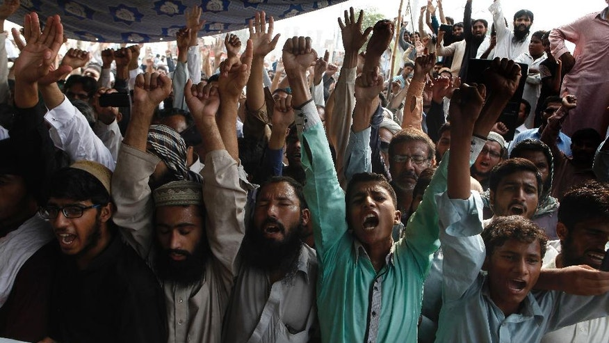 Supporters of Jamaat-ud-Dawa chant anti Indian slogans at a rally in Lahore, Pakistan, Friday, Sept. 30, 2016. Hafiz Saeed, the founding member of banned Lashkar-e-Taiba militant group and head of its charity Jamaat-ud-Dawa has pledged to take revenge from India for killing innocent Kashmiri people. (AP Photo/K.M. Chaudary)