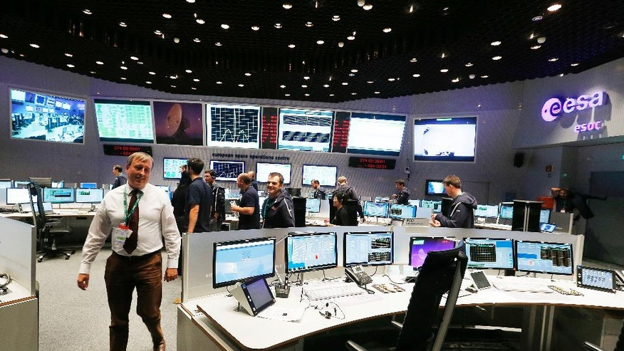 Picture shows view into the control room at the European Space Agency sea in Darmstadt, Germany, Friday, Sept. 30, 2016. Rosetta will be impacted on comet 67P/Churyumov-Gerasimenko on Friday, marking the end of the twelve years lasting Rosetta mission. (AP Photo/Michael Probst)