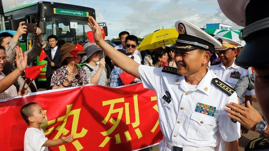 Captain Wang Hong Li, commanding officer of 23rd Chinese naval escort task force, greets local Chinese upon arrival at the Thilawa International Port, Friday, Sept. 30, 2016, in Yangon, Myanmar. Two Chinese naval frigates are paying a port call at the Thilawa port of Myanmar's old capital Yangon. (AP Photo/Thein Zaw)