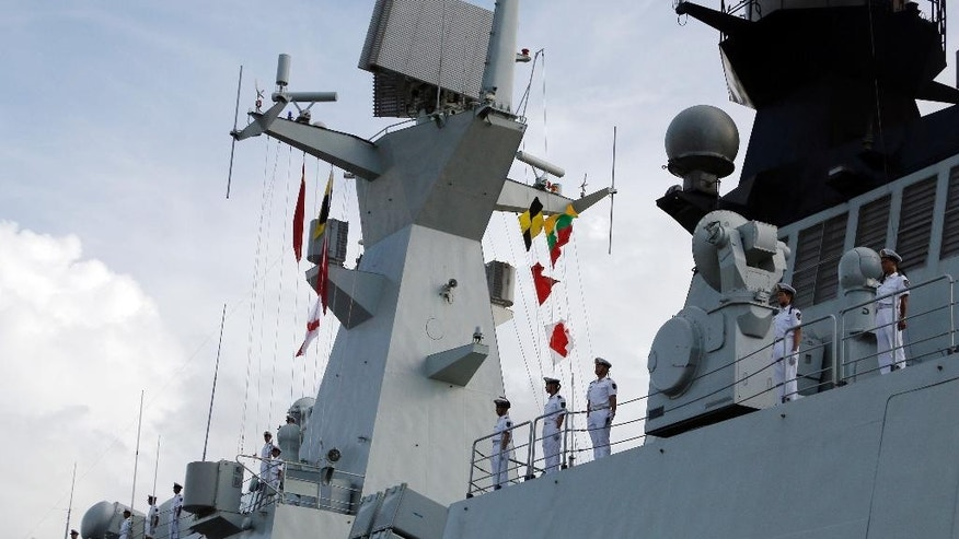Chinese navy officers stand on deck upon arrival at Thilawa International Port Friday, Sept. 30, 2016, in Yangon, Myanmar. Two Chinese frigates, the Zhoushan and the Xiangtan, are both paying a friendly port call at the Thilawa port in Myanmar's old capital Yangon. (AP Photo/Thein Zaw)