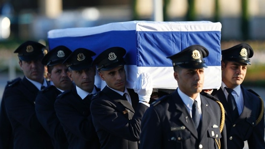 Members of the Knesset guard carry the coffin of former Israeli President Shimon Peres in Jerusalem, Thursday, Sept. 29, 2016.