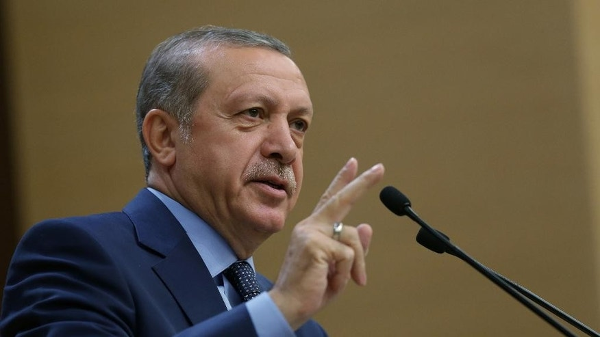 "Turkey's President Recep Tayyip Erdogan addresses a group of local administrators in Ankara, Turkey, Thursday, Sept. 29, 2016. Erdogan hinted on Thursday that the three-month state of emergency declared following the failed July 15 coup could be extended to over a year. Erdogan dismissed criticism over plans for Turkey to prolong the state of emergency, saying no one should determine a ""calendar or roadmap"" for Turkey. (Murat Cetinmuhurdar, Prime Ministry Press Service, Pool via AP Photo)"
