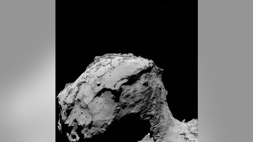 In this photo provided by the European Space Agency ESA Rosetta's OSIRIS wide-angle camera captured this image of Comet 67P/Churyumov-Gerasimenko at 02:17 GMT from an altitude of about 15.5 km above the surface during the spacecraft's final descent on Friday, Sept. 30, 2016. The image scale is about 1.56 m/pixel and the image measures about 3.2 km across. (ESA via AP)