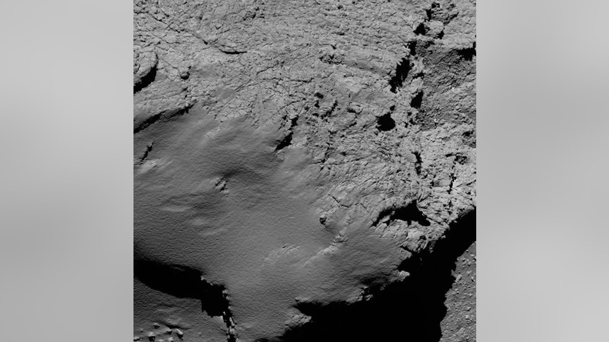 The provided by European Space Agency ESA on Friday, Sept. 30, 2016 was captured by Rosetta's OSIRIS narrow-angle camera captured this image of Comet 67P/Churyumov-Gerasimenko at 08:21 GMT from an altitude of about 5.7 km during the spacecraft's final descent on Friday, Sept. 30, 2016.  (ESA via AP)