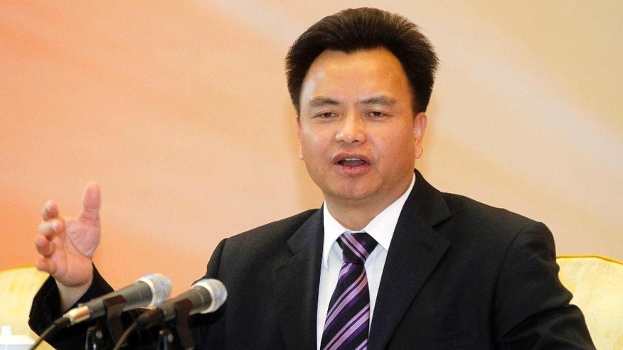 In this May 28, 2012 photo, Wan Qingliang, then-Communist Party chief of Guangzhou, speaks at a lawyers' conference in Guangzhou in southern China's Guangdong province. A pair of formerly high-flying Chinese provincial officials, Wan and Wang Min, were sentenced to life in prison Friday, Sept. 30, 2016, for corruption and bribe-taking, the latest targets to fall in President Xi Jinping's years-long campaign against graft at all levels of government and state industry. (Chinatopix via AP)