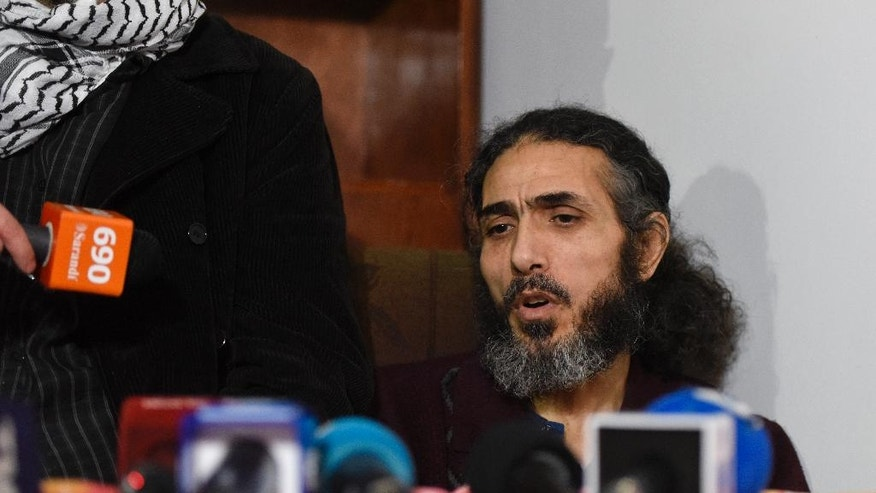 Former Guantanamo detainee Syrian Abu Wa'el Dhiab, speaks during a press conference in his apartment in Montevideo, Uruguay, Friday, Sept. 30, 2016, where he said he is going to stop drinking water on Monday, to press officials into speeding up his relocation to another country. Uruguay's government says it is searching for another country to take Dhiab. Dhiab, who is currently on a hunger strike, says they are taking too long to relocate him. (AP Photo/Matilde Campodonico)