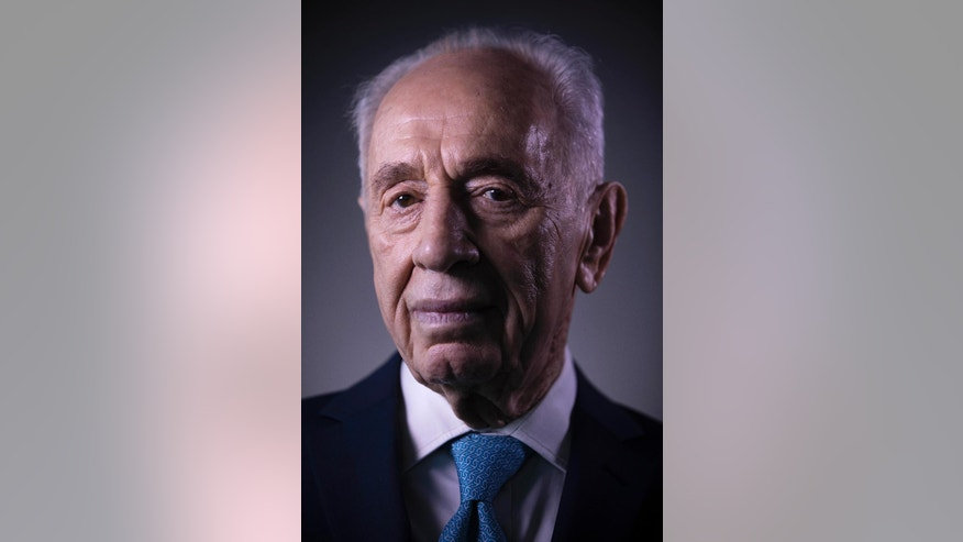 In this Monday, Feb. 8, 2016 file photo, Israel's former President Shimon Peres poses for a portrait at the Peres Center for Peace in Jaffa, Israel. Peres led the government from 1984-86 in a rotation agreement with Yitzhak Shamir. He later served as caretaker prime minister from 1995-96 after Yitzhak Rabin's assassination. Despite his short terms in office, he is credited with disentangling Israeli troops from Lebanon, rescuing its economy from triple-digit inflation in the 1980s and guiding a skeptical nation into peace talks with the Palestinians in the 1990s.(AP Photo/Oded Balilty, File)