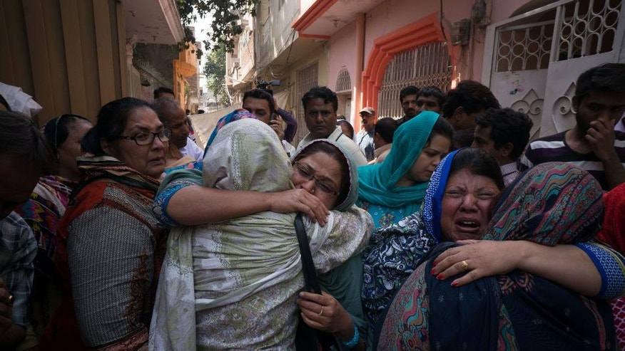 In this Monday, March 28, 2016, photo, Pakistani Christians mourn deaths of their family members and friends in a deadly suicide bombing claimed responsibility by Jamaat-ul-Ahrar, in Lahore, Pakistan. One of Pakistan's most vicious militant groups, Jamaat-ul-Ahrar, has dramatically stepped its attacks over the past month in what appears to be a backlash to military operations against it. It has eclipsed the Pakistani Taliban as the main militant group in a country where multiple armed extremist factions operate. (AP Photo/B.K. Bangash)
