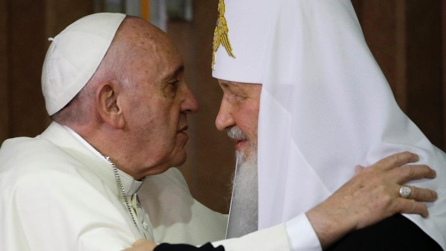 FILE -- In this Feb. 12, 2016 file photo, Pope Francis, left, embraces Russian Orthodox Patriarch Kirill after signing a joint declaration on religious unity in Havana, Cuba.  Pope Francis is wrapping up a Caucasus pilgrimage that began in June in Armenia and ends this weekend with a visit to two other countries with tiny Catholic communities: the Orthodox Christian bastion of Georgia and the largely Shiite Muslim nation of Azerbaijan. (AP Photo/Gregorio Borgia, Pool)