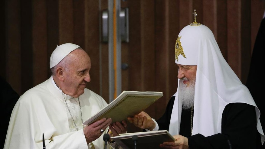 FILE -- In this Feb. 12, 2016 file photo, Pope Francis, left, and Russian Orthodox Patriarch Kirill exchange a joint declaration on religious unity at the Jose Marti International airport in Havana, Cuba. Pope Francis is wrapping up a Caucasus pilgrimage that began in June in Armenia and ends this weekend with a visit to two other countries with tiny Catholic communities: the Orthodox Christian bastion of Georgia and the largely Shiite Muslim nation of Azerbaijan. (AP Photo/Gregorio Borgia, Pool)