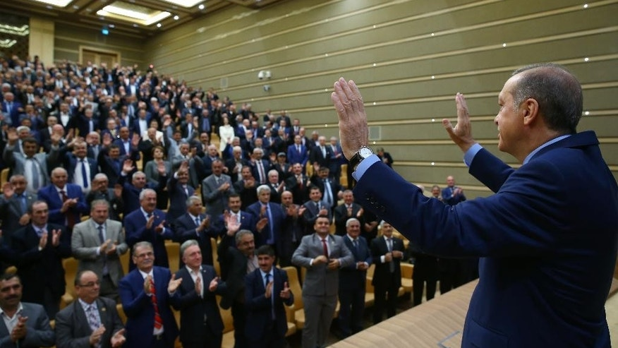 "Turkey's President Recep Tayyip Erdogan addresses a group of local administrators in Ankara, Turkey, Thursday, Sept. 29, 2016. Erdogan hinted on Thursday that the three-month state of emergency declared following the failed July 15 coup could be extended to over a year. Erdogan dismissed criticism over plans for Turkey to prolong the state of emergency, saying no one should determine a ""calendar or roadmap"" for Turkey. (Kayhan Ozer, Prime Ministry Press Service, Pool via AP Photo)"