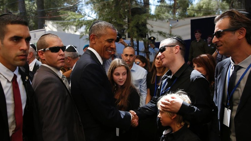 U.S. President Barack Obama condoles family members, after the burial ceremony at the funeral of former Israeli President Shimon Peres on Mount Herzl cemetery in Jerusalem, Friday, Sept. 30, 2016. Shimon Peres was being laid to rest on Friday in a ceremony attended by thousands of admirers and dozens of international dignitaries — in a final tribute to a man who personified the history of Israel during a remarkable seven-decade political career and who came to be seen by many as a visionary and symbol of hopes of Mideast peace. (Ronen Zvulun/Pool photo via AP)