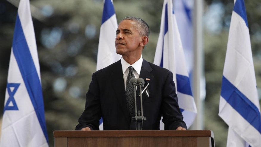 U.S. President Barack Obama pauses as he speaks at a memorial service for former Israeli President Shimon Peres at Mount Herzl national cemetery in Jerusalem, Friday, Sept. 30, 2016. Peres died early Wednesday from complications from a stroke. He was 93. (AP Photo/Carolyn Kaster)