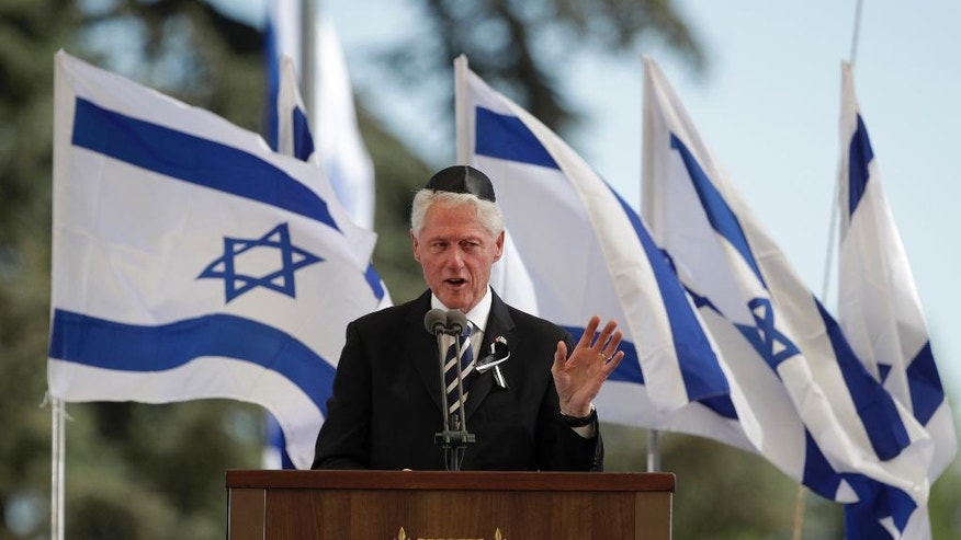 Former US President Bill Clinton speaks at a memorial service for former Israeli President Shimon Peres at Mount Herzl national cemetery in Jerusalem, Friday, Sept. 30, 2016. Peres died early Wednesday from complications from a stroke. He was 93. (AP Photo/Carolyn Kaster)