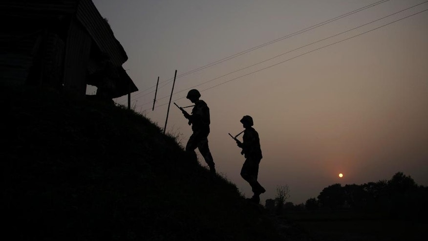 """Indian Border Security Force soldiers patrol near the India-Pakistan international border area at Gakhrial boder post in Akhnoor sector, about 48 kilometers from Jammu, India, Saturday, Oct. 1, 2016. India said Thursday it carried out """"surgical strikes"""" against militants across the highly militarized frontier that divides the Kashmir region between India and Pakistan, in an exchange that escalated tensions between the nuclear-armed neighbors. (AP Photo/Channi Anand)"""