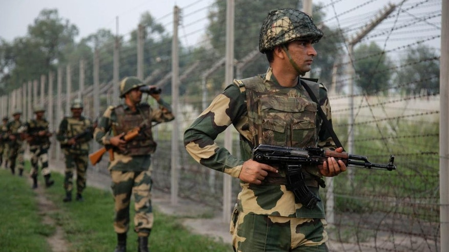 "Indian Border Security Force soldiers patrol near the India-Pakistan international border area at Gakhrial boder post in Akhnoor sector, about 48 kilometers from Jammu, India, Saturday, Oct. 1, 2016. India said Thursday it carried out ""surgical strikes"" against militants across the highly militarized frontier that divides the Kashmir region between India and Pakistan, in an exchange that escalated tensions between the nuclear-armed neighbors. (AP Photo/Channi Anand)"