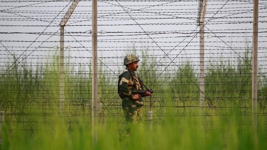 """An Indian Border Security Force soldier patrols near the India-Pakistan international border area at Gakhrial boder post in Akhnoor sector, about 48 kilometers from Jammu, India, Saturday, Oct. 1, 2016. India said Thursday it carried out """"surgical strikes"""" against militants across the highly militarized frontier that divides the Kashmir region between India and Pakistan, in an exchange that escalated tensions between the nuclear-armed neighbors. (AP Photo/Channi Anand)"""