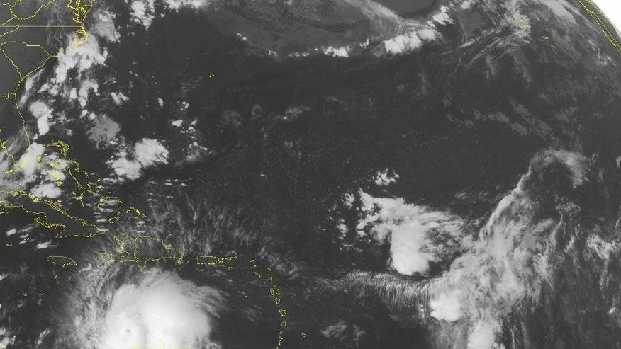 This NOAA satellite image taken Saturday, Oct. 1, 2016 at 12:45 AM EDT shows well defined Hurricane Matthew continuing to slowly move westward at about 7 MPH across the Caribbean. Recent reconnaissance missions have revealed max sustained wind speeds up to 160 MPH, bringing Matthew up to a category 5 hurricane. Some of the outer bands can be seen pushing into Hispaniola, as well as Venezuela and Columbia. Matthew is expected to begin its northward turn over the next few days, largely impacting Jamaica next.  (NOAA/Weather Underground via AP)