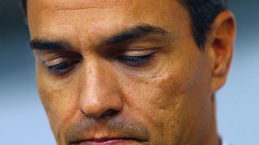 Spain's Socialist leader Pedro Sanchez looks down as he gives an statement during an appearance before the press in the party headquarters in Madrid, Spain, Friday Sept. 30, 2016.  A growing leadership battle has been raging within Spain's main opposition Socialist party and has threatened to tear the 137-year-old organization apart and hurl the country toward an unprecedented third election in a year.  The party will hold a crucial federal committee on Saturday  that may be unable to resolve the schism between those for and against leader Pedro Sanchez. (AP Photo/Francisco Seco)